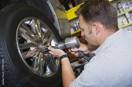 Mechanic Putting Tire on a Car