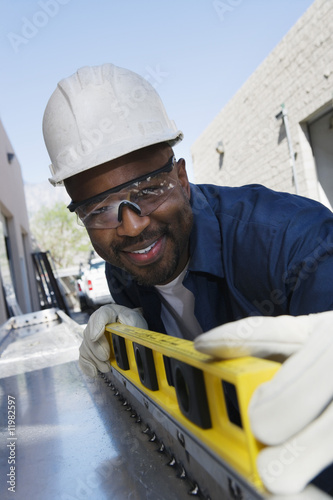 Workman Using a Level