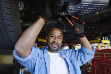 Auto Mechanic Beneath a Car