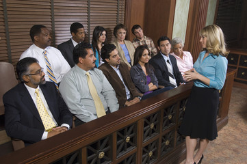 female attorney addressing jury, elevated view