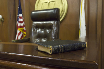 Bible beside judges chair in court