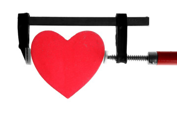 clamp grip tool pressing red heart
