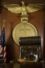 Gavel near judges chair in court room