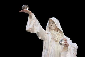 White Wizard manipulating christal balls