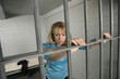 Female criminal behind bars in jail