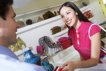 Clerk Handing Receipt to Customer