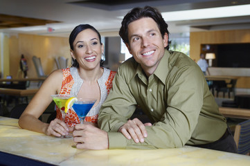 Couple Drinking Martinis at a Bar