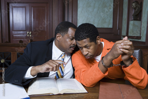 Criminal with lawyer in court