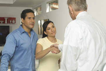 Businessman Shaking Hands with Couple