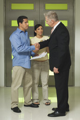Businessman Assisting Couple