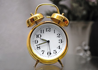 Golden alarm clock