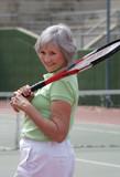 Active Senior Playing Tennis poster