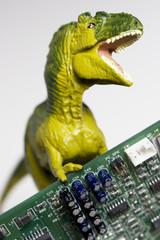 Dinosaur figurine with circuit board on white