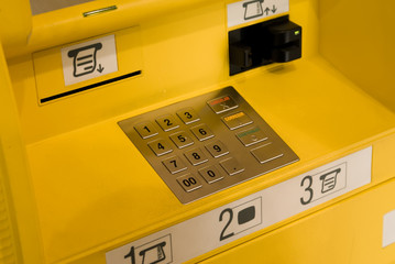 Close-up of the yellow automatic cash terminal keyboard