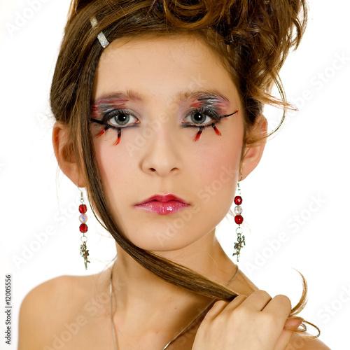 Face closeup of girl with special eye makeup