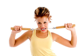 young female holding nunchaku