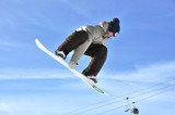 Aeroski: girl snowboarder on a high jump