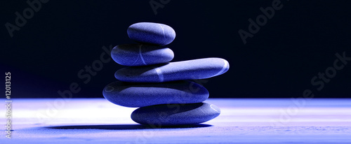 pile of five stones in blue lighting