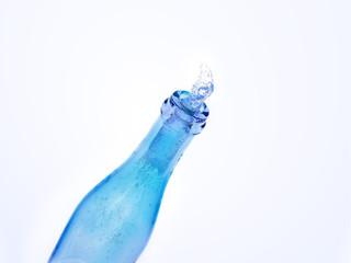 Blue bottle with splash