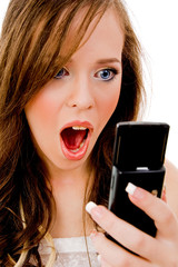 close view of shocked model looking at mobile