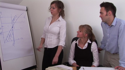 Businesswoman interacting with her team