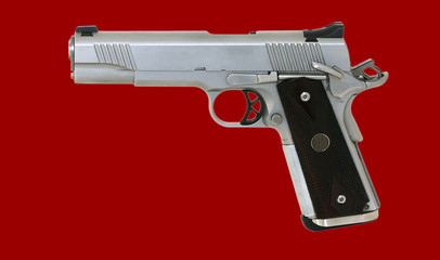45 caliber pistol isolated on red