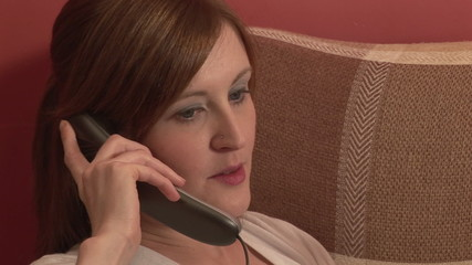 Close-up of an attractive woman talking on the phone