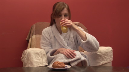 Beautiful woman with croissant and orange juice