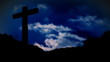 Crucifix with blue clouds background