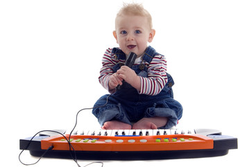Baby sings and plays keyboard