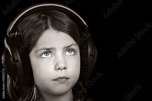 Shot of a Blue Eyed Child with Headphones