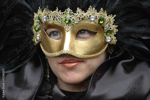 golden mask, black dress, blue eyes