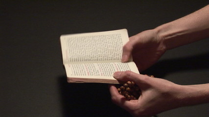 reading a bible with rosary
