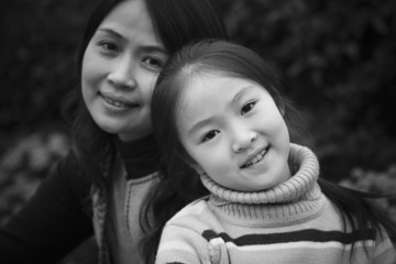 black and white portrait of mother and daughter
