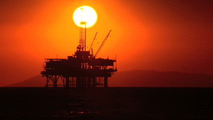 Oil Platforms At Sunset