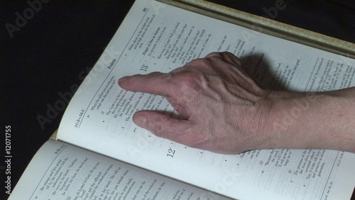 Old woman reading bible