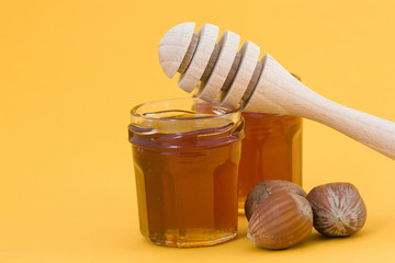 hazelnuts, honey and wooden drizzler
