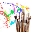 Several brushes with paint splashes behind them