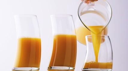 Pouring orange juice. ( Digital Cinema, HD, 1080p )