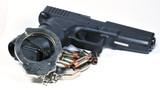 Handgun with handcuffs and bullets