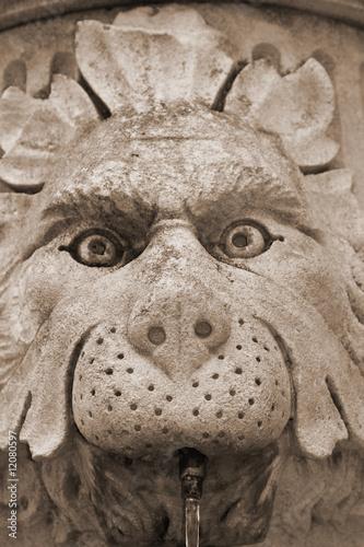Street statue-fountain in croatian town Dubrovnik - 12080597