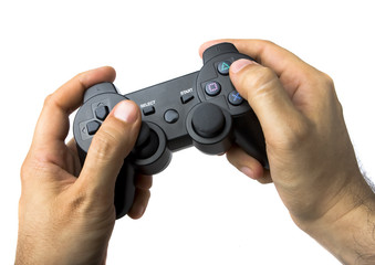 Male Hand Using Console Game Controller on White