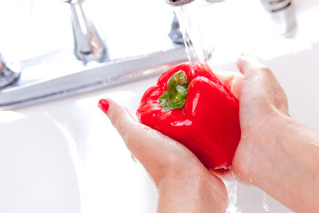 Woman Washing Red Bell Pepper