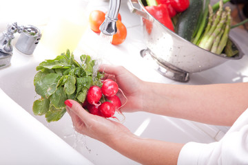 Woman Washing Radishes