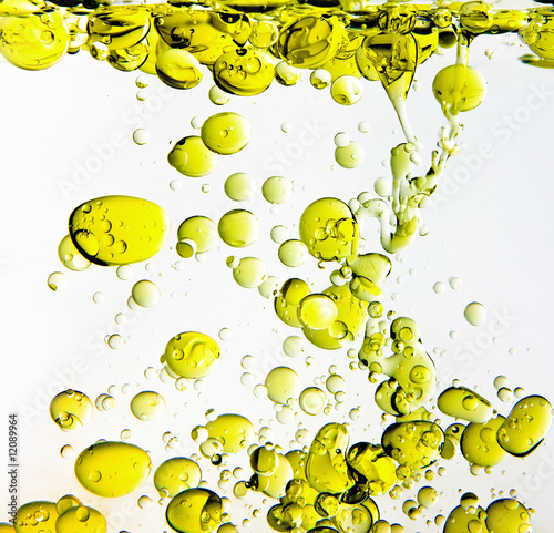 Olive Oil Poured into Water - 12089964
