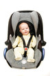 baby in car seat over white