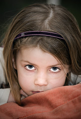 Cute Child Resting Head on Cushion