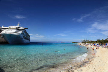 Cruise ship docked in tropical island beach port