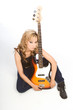 Blond Latina woman guitarist sitting on floor