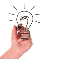 woman hand drawing light bulb on white background